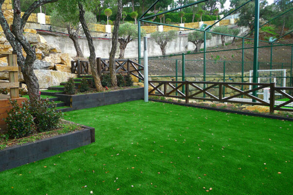 Artificial lawn next to steps and tennis court at La Zagaleta